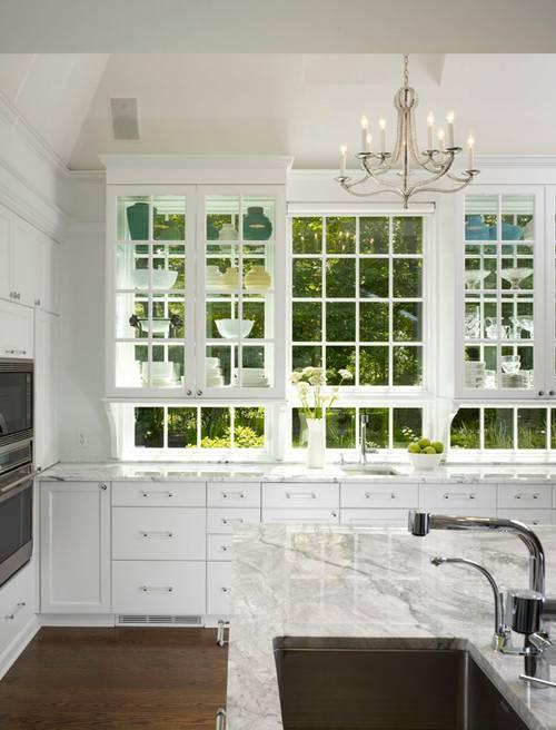 stove under window stainless steel with shelf big refrigerator window beside island beige marble white cabinets