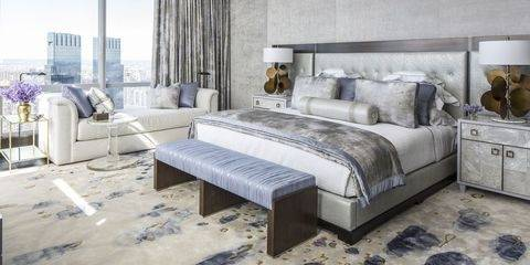 The headboard is made  with a beautiful grey upholstery that resembles velvet