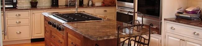Hershing dark Cherry cabinets with a large white kitchen island