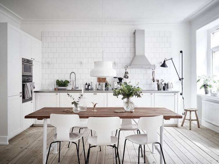 White Scandinavian kitchen with a flood of natural light and herringbone floor [From: Sven