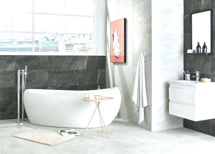 bath with grey panels in light grey room