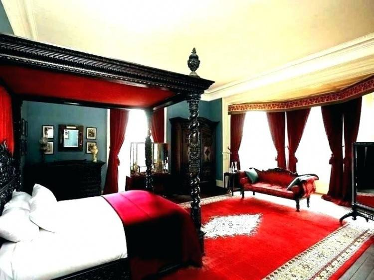 Red bedroom walls,& padded headboard, black bedding & accessories