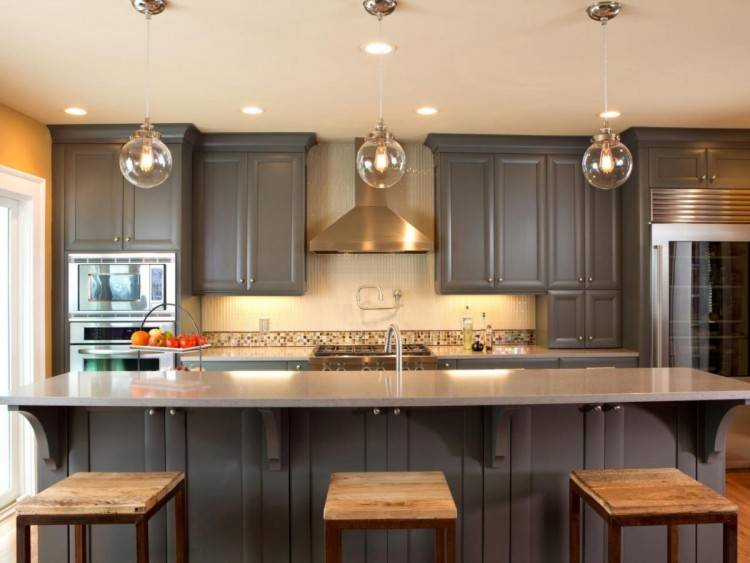 Like two colors of cabinets, copper backsplash and exposed brick