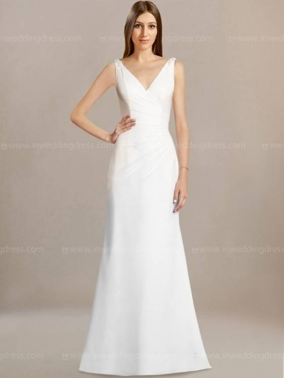 This long sleeve modest bridal gown features a bold lace pattern and a darling sleeve