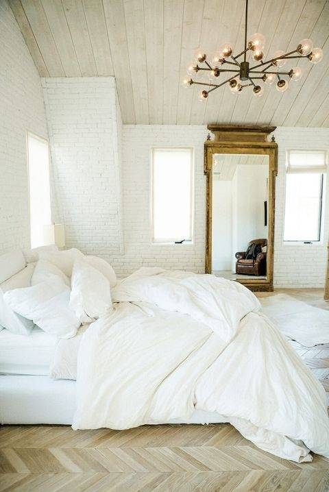 An inviting mix of textures and tranquil tones in this appealing bedroom